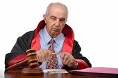 foto of judiciary  - Senior adult judge breaking pencil meaning capital punishment according to some judiciary systems - JPG