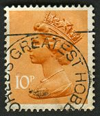 UK-CIRCA 1993:A stamp printed in UK shows image of Elizabeth II is the constitutional monarch of 16
