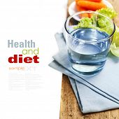 Water, carrot and lettuce - diet and healthy eating concept - over white (with easy removable sample text)