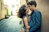 Young Couple Kissing In The Street Of The Old City In Spain