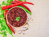Adjika With Hot Pepper And Parsley On Burlap