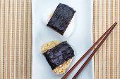 Japanese rice balls (onigiri) on plate over