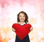 love, children and happiness concept - beautiful girl with big heart