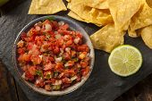 stock photo of dipping  - Homemade Pico De Gallo Salsa and Chips Ready to Eat - JPG