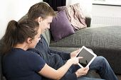 Happy couple using tablet pc
