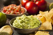 foto of nachos  - Green Homemade Guacamole with Tortilla Chips and Salsa - JPG
