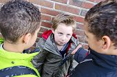 image of attitude boy  - Two big bullies taking on a smaller kid - JPG