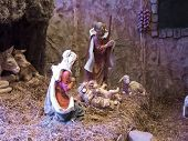 stock photo of manger  - Life Size Nativity display with animals straw bed manger - JPG
