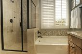 picture of bathroom sink  - White shutters in bathroom window - JPG