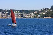 stock photo of dartmouth  - dinghy sailing off the coast at Dartmouth - JPG