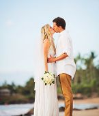 Bride and Groom, Romantic Newly Married Couple Kissing at the Beach, Just Married