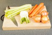 stock photo of celery  - Stock ingredients celery carrots fennel and union on wooden cutting board - JPG