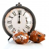 Dutch traditional oliebollen and clock on twelve isolated over white background