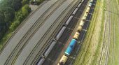Freight trains on railways at sunny day. View from unmanned quadrocopter.