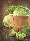 Still Life With Assortment Cabbages On Wooden Background