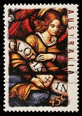 AUSTRALIA - CIRCA 1995: A stamp printed in Australia shows Angel with Gloria in excelsis Deo Banner,