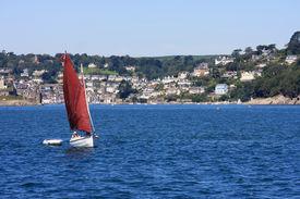 stock photo of dartmouth  - dinghy sailing off the coast at Dartmouth - JPG