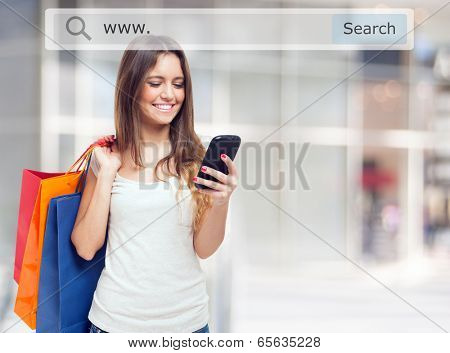 Young woman holding shopping bags and a mobile phone poster