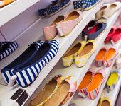 stock photo of platform shoes  - Background with shoes on shelves of shop - JPG