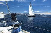 Yachting, sailing regatta. Sailing ship yachts with white sails. Luxury yachts.