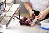 Chef Slicing Boiled Beetroot