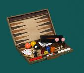 Board Games In A Wooden Box Isolated On Green