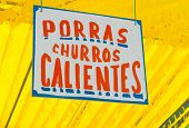stock photo of churros  - Poster in a fair announcing porras and churros calientes - JPG