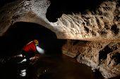 Cave Explorer, Speleologist Exploring The Underground