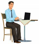stock photo of internet-cafe  - young businessman sitting in an Internet cafe - JPG