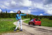 Hitch-hiking By Young Teenage Girl