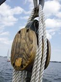 Close-up of a rope tied up with a pulley of boat