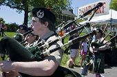 City of Winchester Pipes and Drums performing at the Delaplane Strawberry Festival at Sky Meadows St