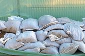 foto of sandbag  - Wall of sandbags and tarp for flood protection - JPG