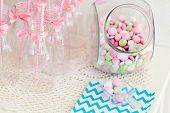 stock photo of buffet  - Candy jar on a dessert table at party or wedding celebration - JPG