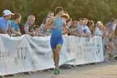 DNEPROPETROVSK, UKRAINE - MAY 24, 2014: Sergiy Kokhan of Ukraine runs on the third stage of ETU Spri
