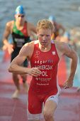 DNEPROPETROVSK, UKRAINE - MAY 24, 2014: Mateusz Kazmierczak of Poland finished the swimming stage of