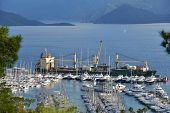MARMARIS, TURKEY - MAY 2, 2014: Unloading yachts from the ship. Marmaris yacht marina is one of the