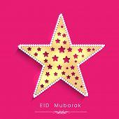 Greeting card design with golden star on pink background for celebration of Muslim community festival Eid Mubarak.
