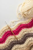 Crochet hook with crocheted blanket