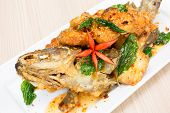 stock photo of grouper  - deep fried sweet and sour spicy sauce grouper fish - JPG