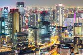 Osaka skyline and skyscraper building at night Japan