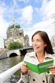 Tourist woman on boat tour Berlin, Germany having fun smiling happy while enjoying mini cruise readi