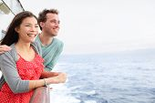 Cruise ship couple romantic on boat looking at view in romance. Happy lovers, woman and man travelin