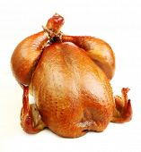 stock photo of spit-roast  - Roast chicken isolated on white background - JPG
