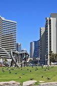 TEL AVIV, ISRAEL - MAY 2, 2014: Beautiful Tel Aviv promenade. On the green lawn in front of the hote