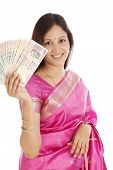 Young Traditional Woman Holding Indian Currency