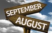 Time concept on wooden sign, September x August