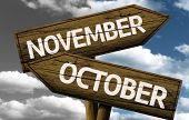 Time concept on wooden sign, November x October