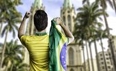 Man holding the brazilian flag in Se Cathedral, Sao Paulo, Brazil
