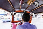 stock photo of rickshaw  - Tuktuk moving along a street in Bangkok - JPG
